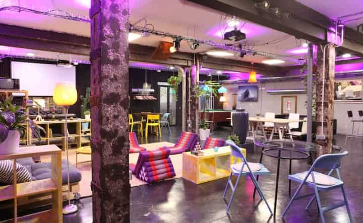 Industrial reception venue with quirky lighting and furniture