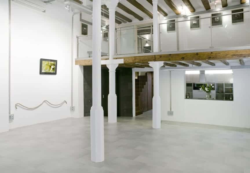 White event hall with wooden ceiling beams