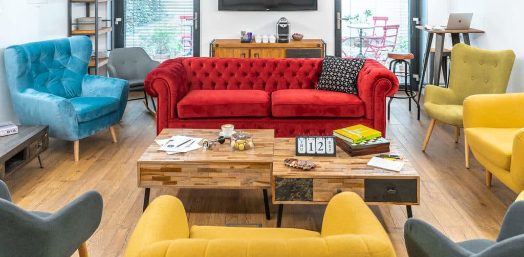 Cosy workshop room with colourful lounge sofas