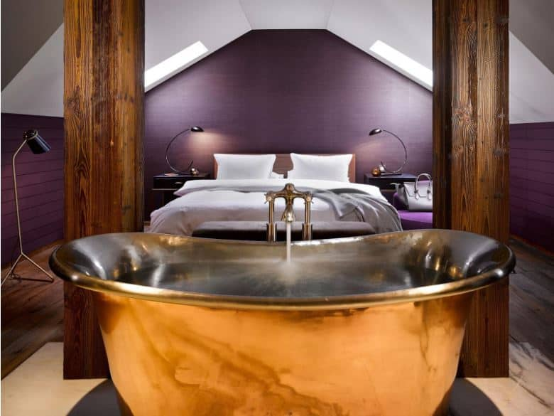 Luxurious hotel room with a copper bath