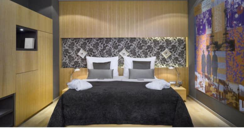 Modern hotel room with artsy walls
