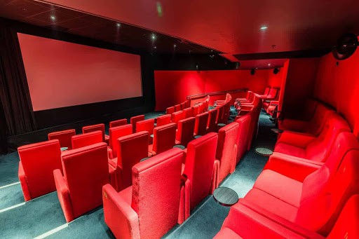 Quirky Screening Room Painted in Red