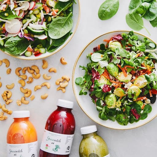 fresh salade. dry fuits and bottles with juice