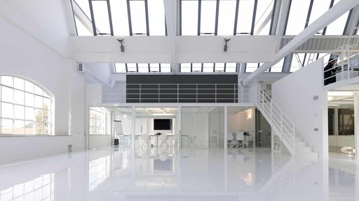 White Hackathon Venue in Milan with an Uncluttered Design