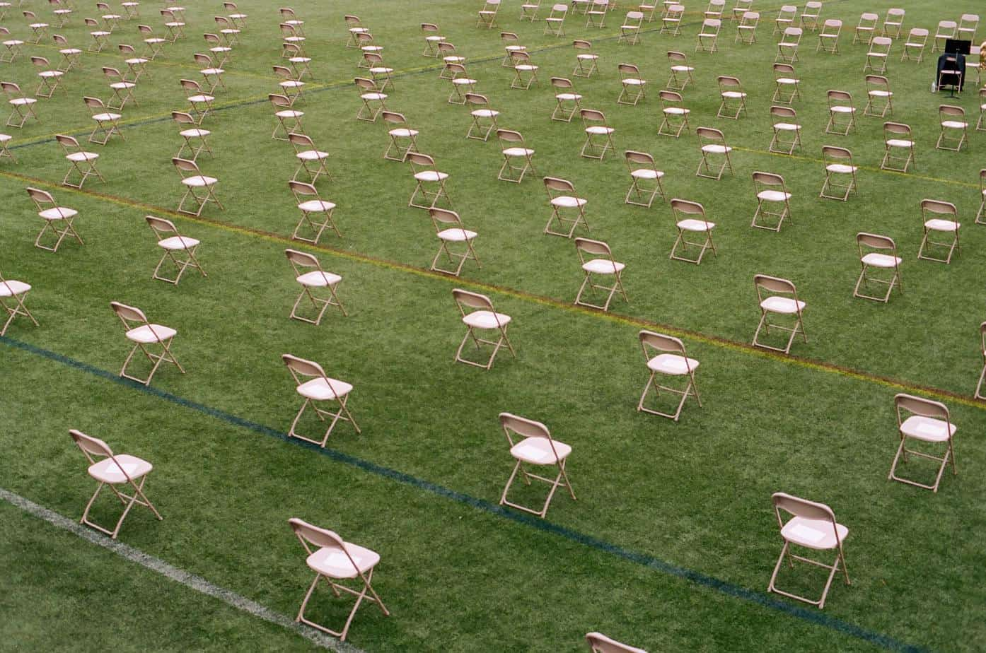 Chairs in a green field conference venue