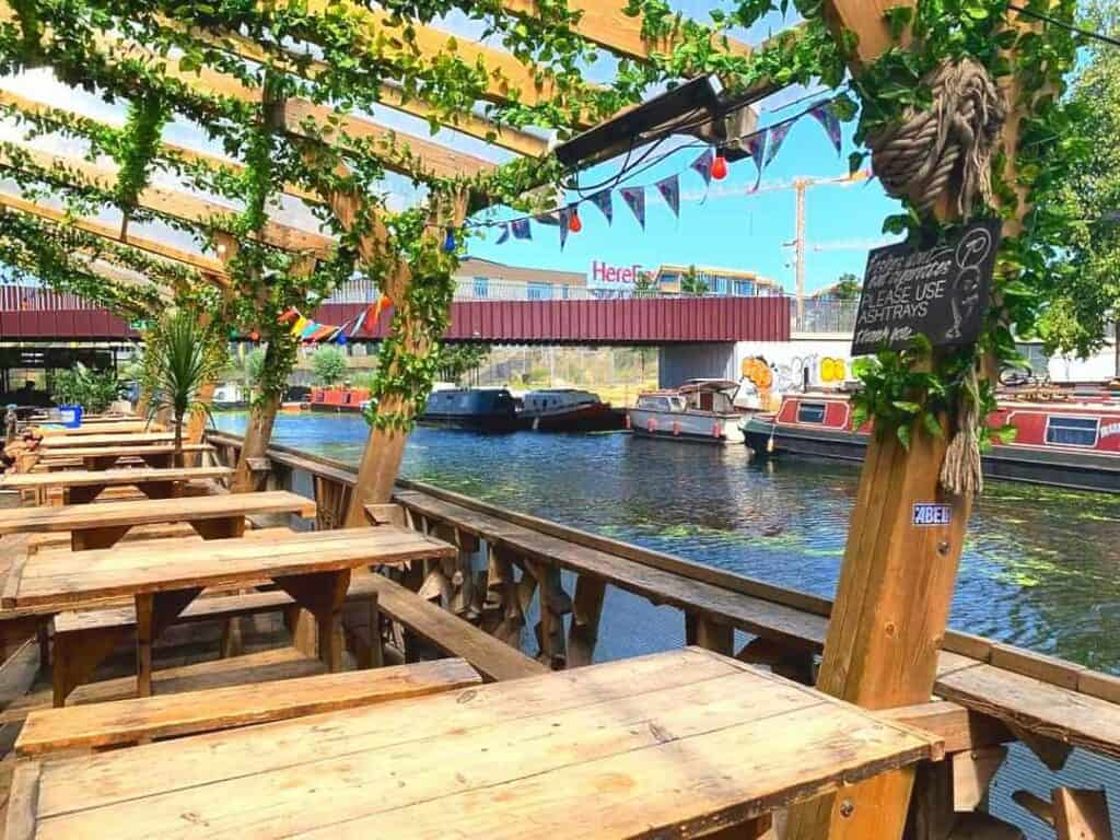 Canal-side restaurant with modish features boasting hand-crafted wooden decor.