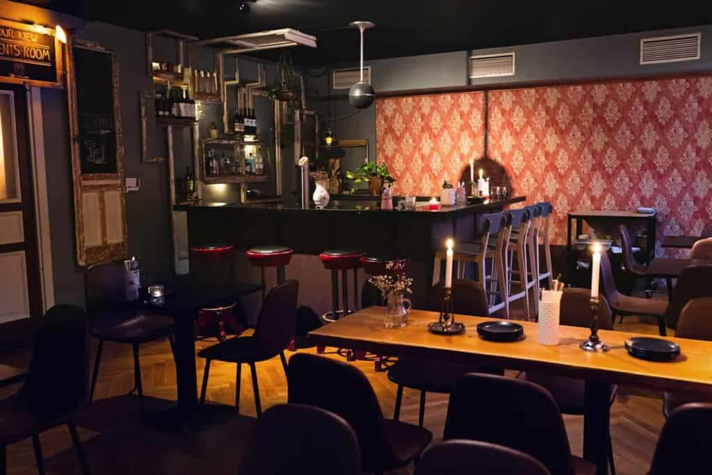 Contemporary and classy restaurant in the heart of Berlin with subdued lighting and wood furniture.