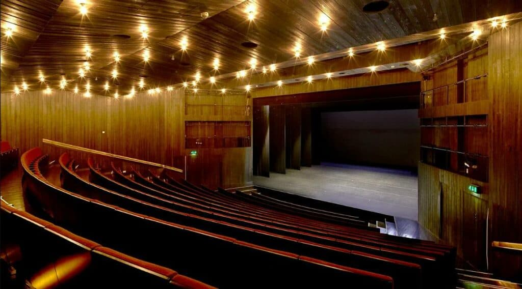Elegant theatre with a stylish dark wood interior and a rich vintage look.